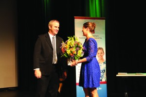IEUA-QNT President AndrewElphinstone presents guest speaker Cori Brooke with flowers